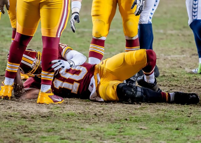 RG3 takes an involuntary knee. Photo credit: my husband