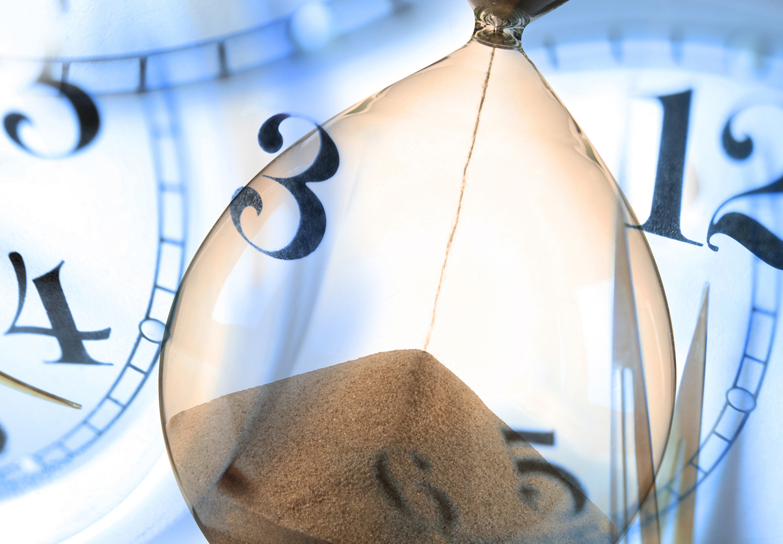 abstract-time-brown-hourglass-sand-and-blue-clockfaces
